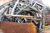 Scrap iron in a controlled landfill for recycling bulky waste — Stock Photo
