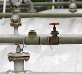 Valve to bleed off the large reservoir in refining plant — Stock Photo