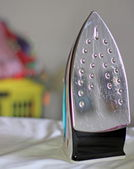 Ironing after ironing cools many shirts — Stock Photo