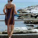 Elegant woman on the Pier — Stock Photo #44429357
