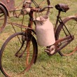 Bikes of ancient milkman with aluminium drum — Stock Photo