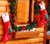 Stockings of the befana in wall hanging — Stock Photo