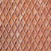 Metal grill and rusty iron diamonds — Stock Photo