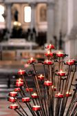 Many Red candles inside a church — Stock Photo