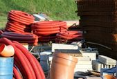Storage of building material and red tubes — Foto Stock