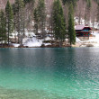 Постер, плакат: Alpine hut on the shore of the Lake with fresh water and Crystal