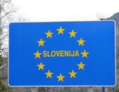 Blue sign with yellow stars of European border Slovenija 1 — Stock Photo