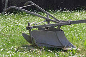Sturdy bit of ancient iron plow for plowing the land — Stock Photo