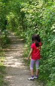 Young little GIRL lost in the Woods trail — Stock Photo