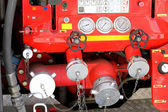 Taps and valves of trucks of firefighters with measuring gauges  — Stock Photo