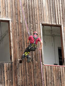 Brave fireman climber expert you haul in the wall of the House a — Stock Photo