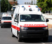 Two ambulances in the street run fast to the place of accident — Foto de Stock