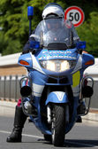 Police motorcycle COP while patrolling the road and check motori — Stock Photo