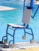 Ingenious Chair for disabled people to make use of the pool for  — Stock Photo