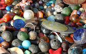 Pendants for necklaces decorations handmade by a craftsman in Af — Stock Photo