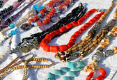 Red necklaces with other jewelry for sale in the vintage shop — Stock Photo