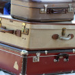 Three old leather suitcases at the market of vintage and retro — Stock Photo