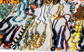 African origin vintage necklaces for sale at flea market stall — Stock Photo