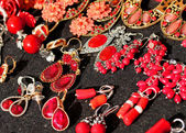 Red stones earrings for sale flea market finds and ancient thing — Stock fotografie