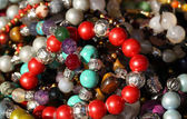 Red bracelets and necklaces  for sale in the jeweler's shop — Stock Photo