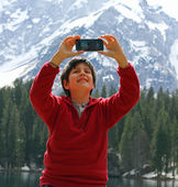 Selfie of a child with the background of dolomities — Stock Photo