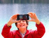 Selfie of a child with the background of Alpine Lake — Stock Photo