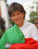 Young boy with flag before the football match — Foto Stock
