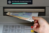 Withdraw money in banknotes from an ATM — Stock Photo