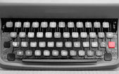 Keyboard of an typewriter in metal with a red button — Stockfoto