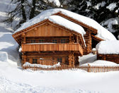 Chalet in the mountain with white snow — Stock Photo