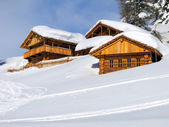 Chalets in the middle of the snow high in the italian Dolomites — Stock Photo
