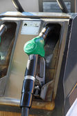 Gas pump into a distributor of automotive fuel — Stock Photo