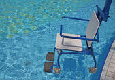 Wheelchair for the disabled for use in swimming pool 2 — Stock Photo