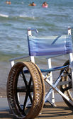 Wheel chair with steel wheels — Stock Photo