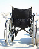 Black wheelchair from behind with rubber wheels — Stock Photo