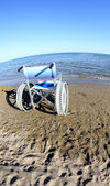 Wheelchair to ensure the mobility of disabled people on the beac — Stock Photo
