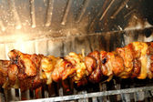 Excellent skewers of meat cooked on a spit in the fireplace 3 — Stock Photo