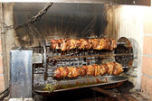 Skewers of meat cooked very slow focus and rotated several times — Stock Photo