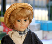 Old Doll's face with long hair for sale in antiques shop 2 — Stock Photo