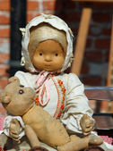 Old rag doll with the teddy bear for sale in antiques shop — Stock Photo