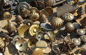 Collection of ancient bronze handles at flea market — Stock Photo