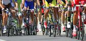 Bicycle race with athletes engaged in road slope — Stock Photo