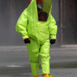 Rescuer with the yellow suit against biological hazard from cont — Stock Photo #51211415
