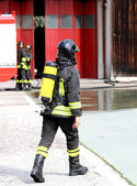 Firefighter with oxygen tank in action 2 — Stock Photo