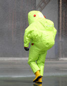 Man with the jumpsuit for the biohazard during a chemical warfar — Stock Photo