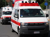Two ambulances on the road run to the place of accident — Stock Photo