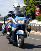 Police motorcycles and the COP that controls the way — Stock Photo