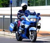 Police motorcycles and the COP that controls the road — Stock Photo