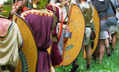 Historical reconstruction of a battle and the Roman men — Stock Photo