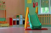 Slide and games inside a school for young children — Stock Photo